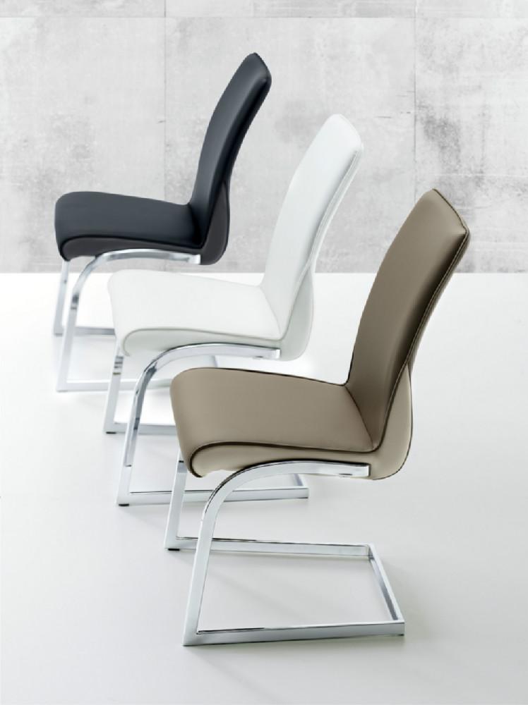 Sillas de estilo moderno en acero y polipiel for Sillas estilo moderno